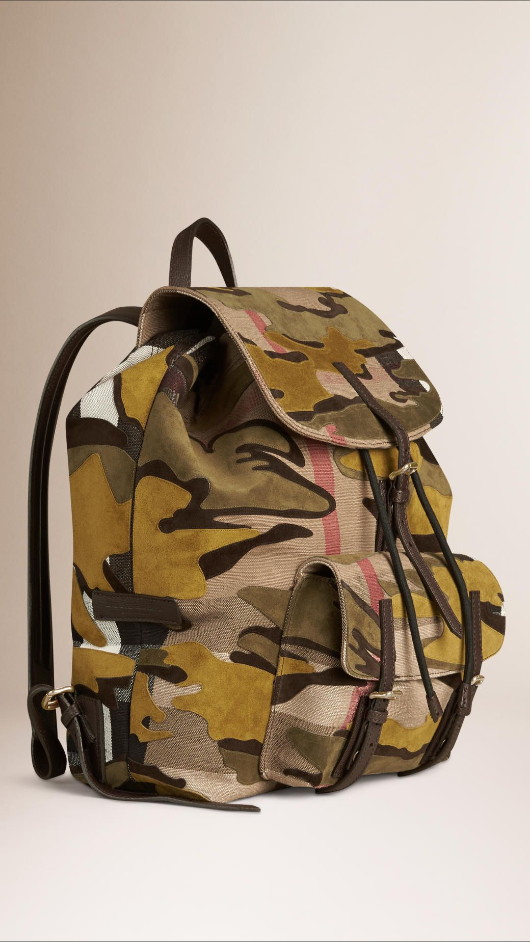 b6628c033ee8 Burberry   An Italian-made Canvas check backpack featuring a bonded suede  camouflage pattern.