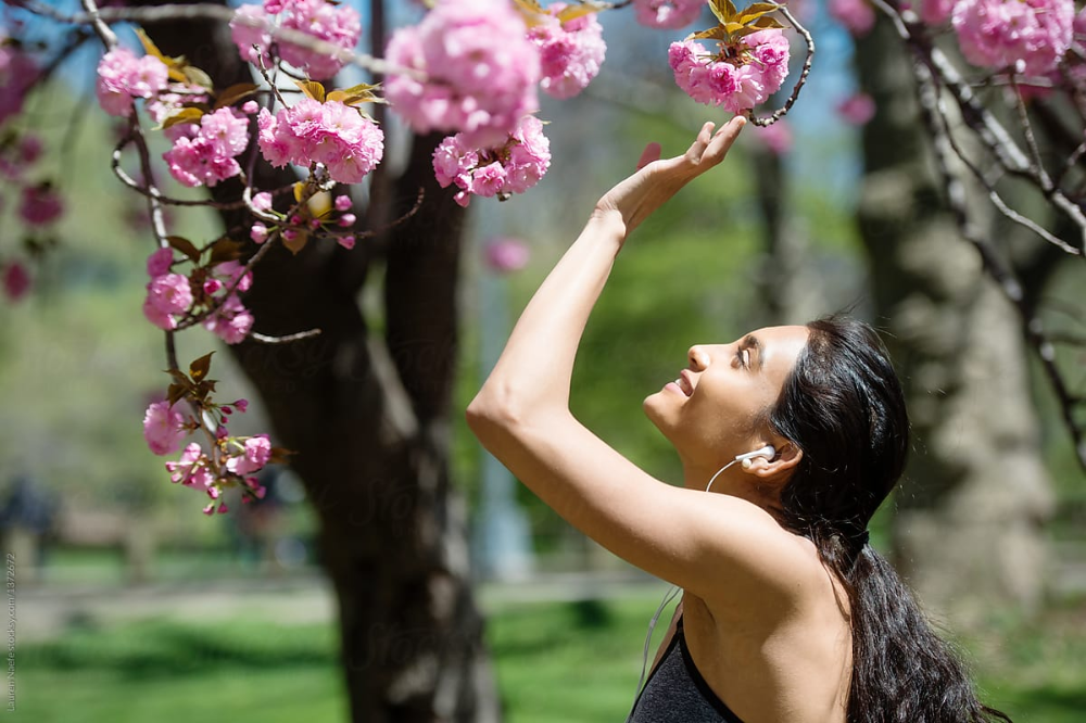 Young Woman Athlete Under Cherry Blossom Tree In Park In Springtime Enjoying Nature Enjoyment Nature Enjoy Nature