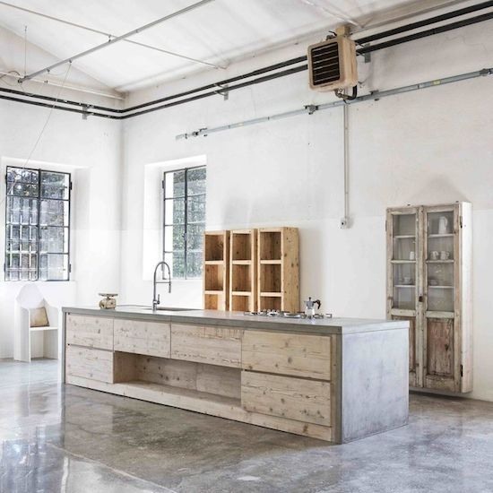 concrete bench top with concrete floors and timber details