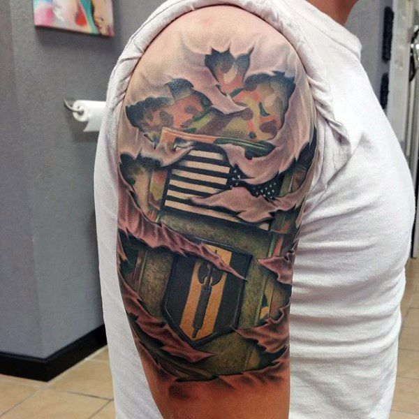 Male tatto of army badge patch on upper arm ripped skin for Camo sleeve tattoo
