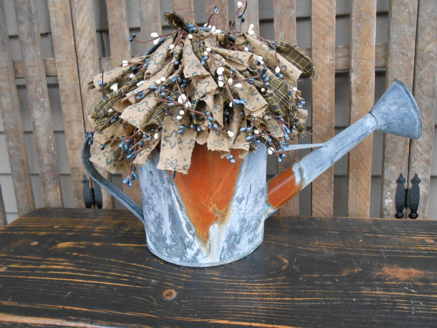 Rusty / Galvanized Watering Can Floral Arrangement-Country-Garden-Farmhouse-Cottage-Primitive-Lodge-Rags & Berries. $30.00, via Etsy.