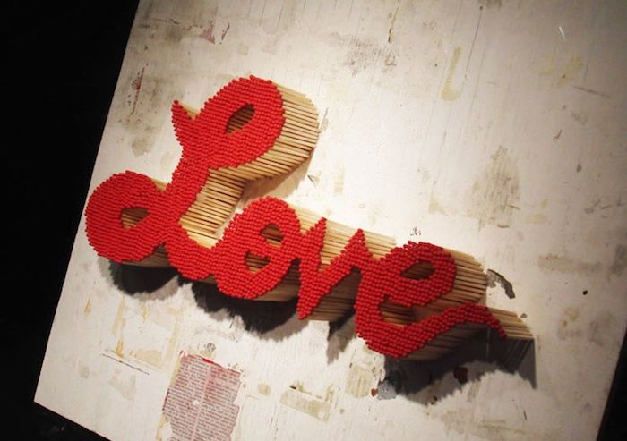 Made up of about 2,500 match sticks and taking a total of 24 hours to complete, Ng created Passion, or the word love hand drawn and spelled out in vintage type