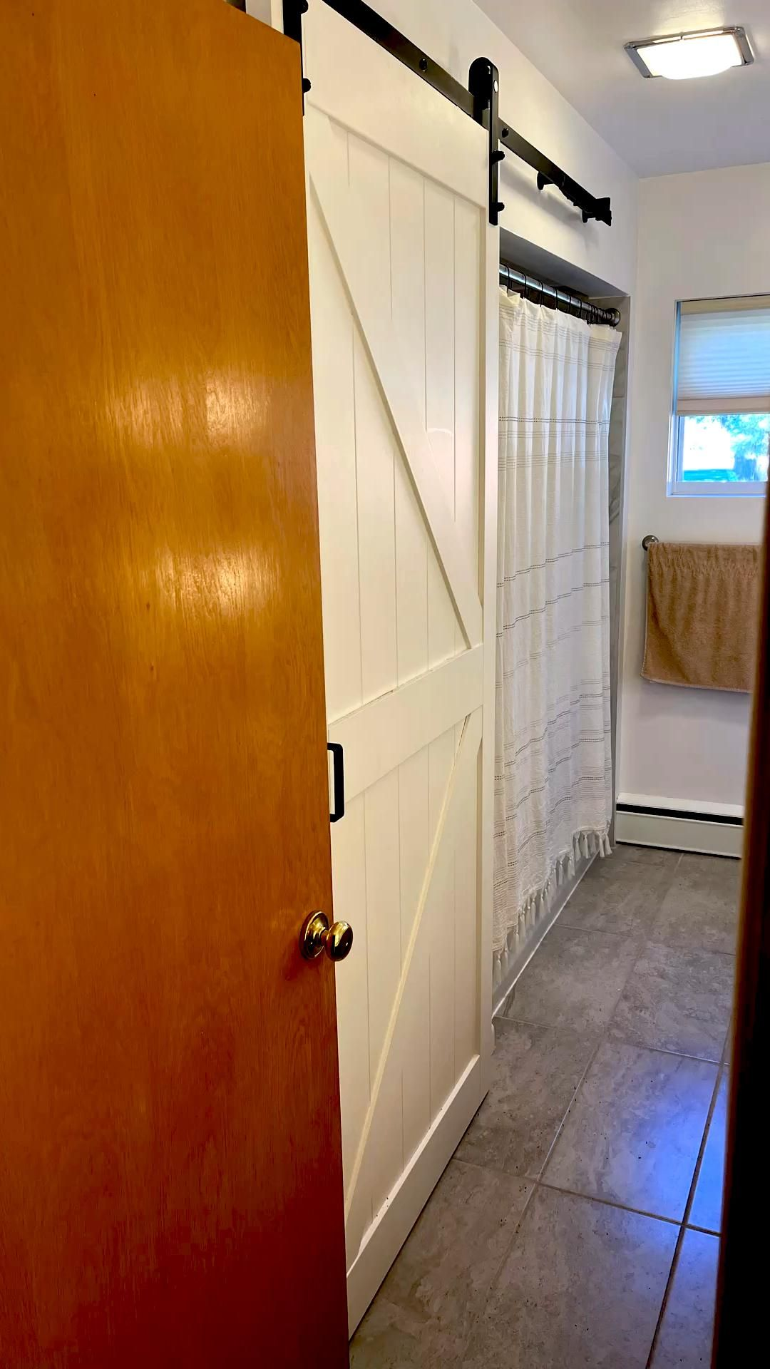 Barn doors for the bathroom closet. Created so much more roo…