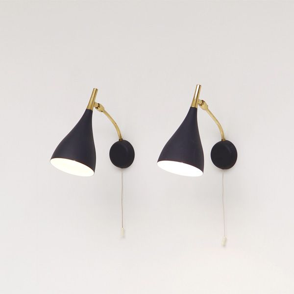 A pair of 1950s black wall scones, produced by Kosack ::