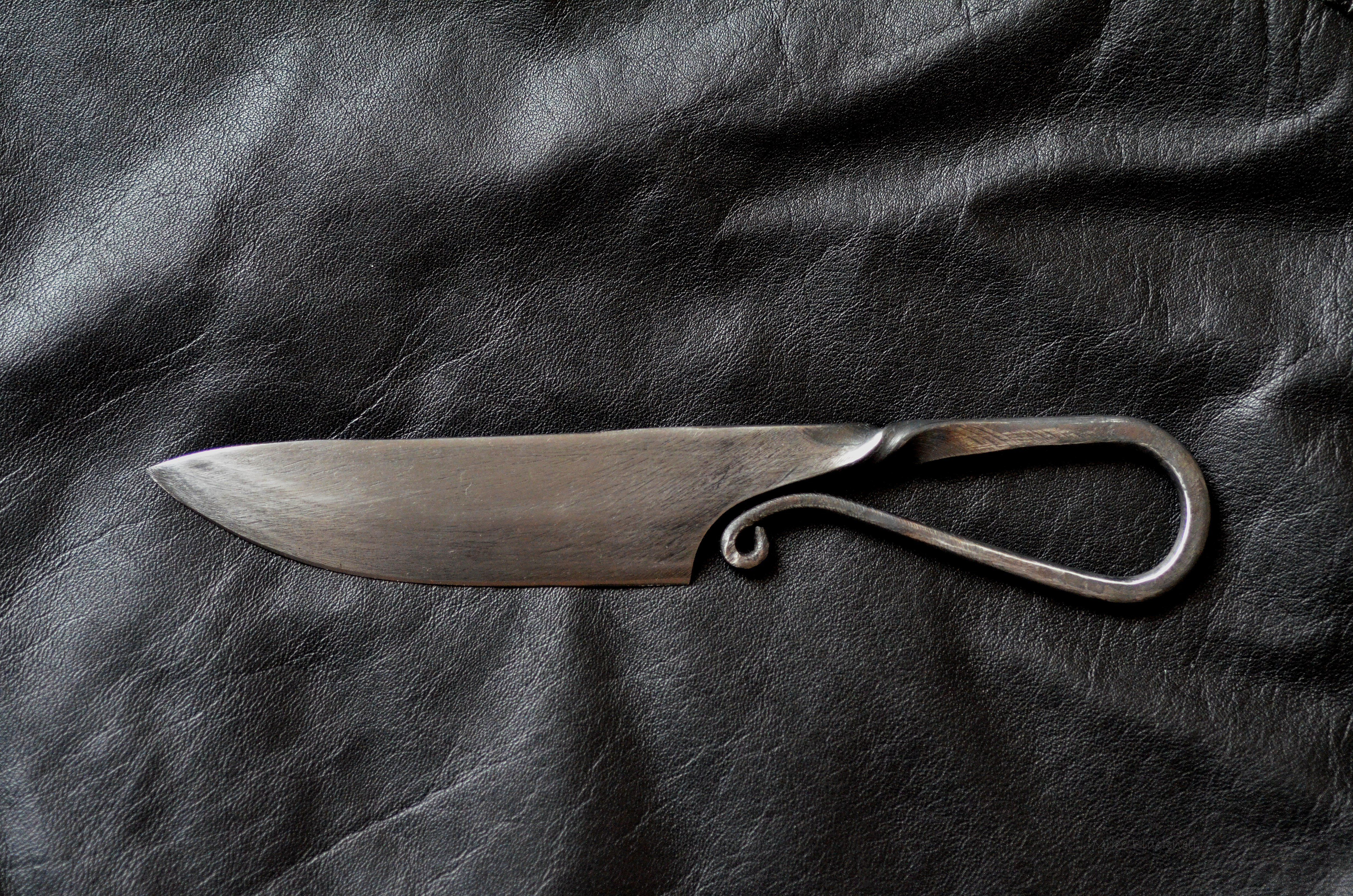 This viking style knife was forged from an old farriers file then hardened and tempered
