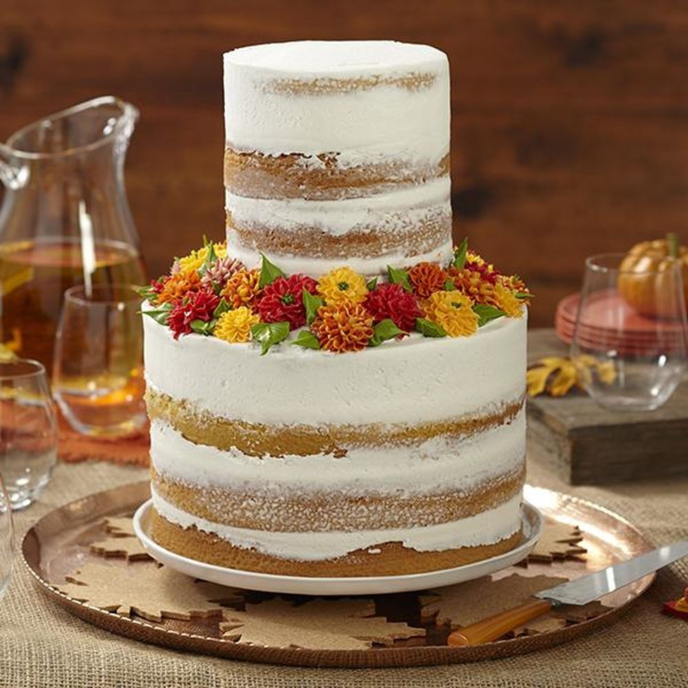 This beautiful full cake features an undone naked cake look thats