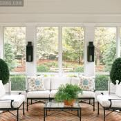 A screened-in porch can feel just like another indoor room with comfy pillows and eye-catching sconces.