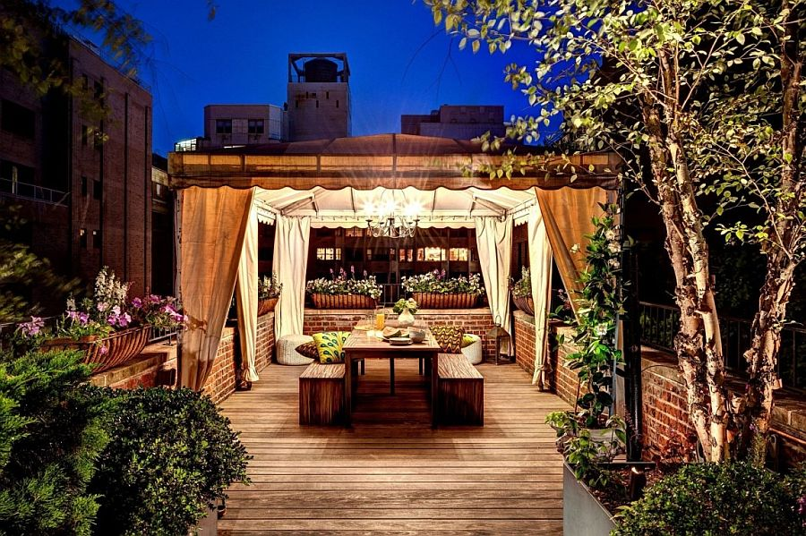 An Outdoor Dining E Nestled Among Natural Greenery Of The Rooftop Garden