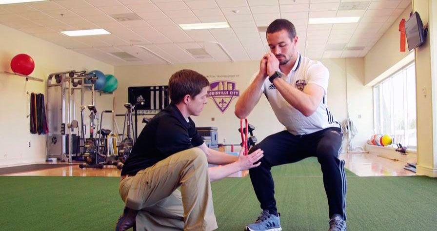 Sports medicine physician Mark Puckett and trainer Scott