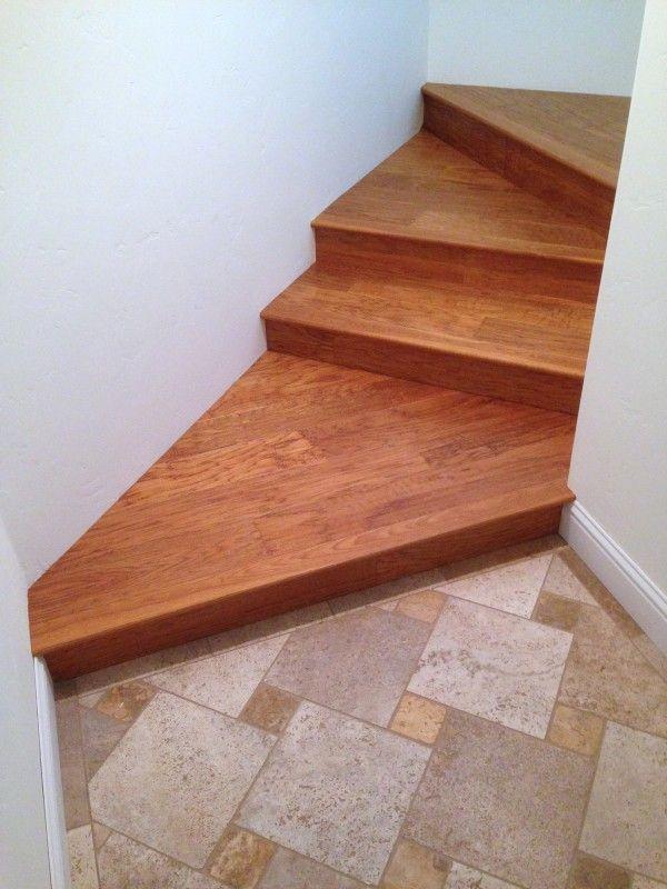 Diagonal Landing Against Travertine Tile Stairs