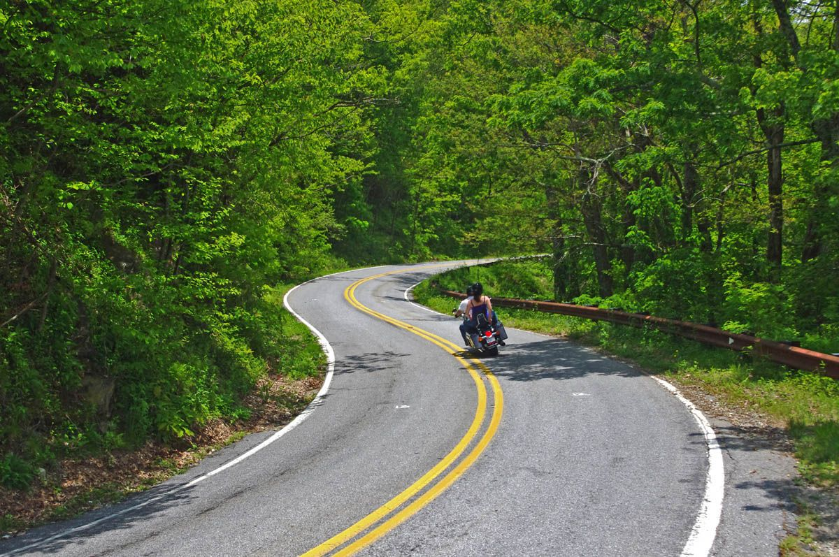 "Snaking down US 276 on the north side of the Blue Ridge Parkway yesterday, one of the most challenging sections of road you'll find. Look close to see the painted marks on the pavement indicating it's soon to be resurfaced. I saw a crew marking this fabulous 3 mile section of curves yesterday. Much needed, it's a rough and bumpy ride right now. All part of rides I call ""The Pisgah Triangles"", a must do on your visit! http://americaridesmaps.com"