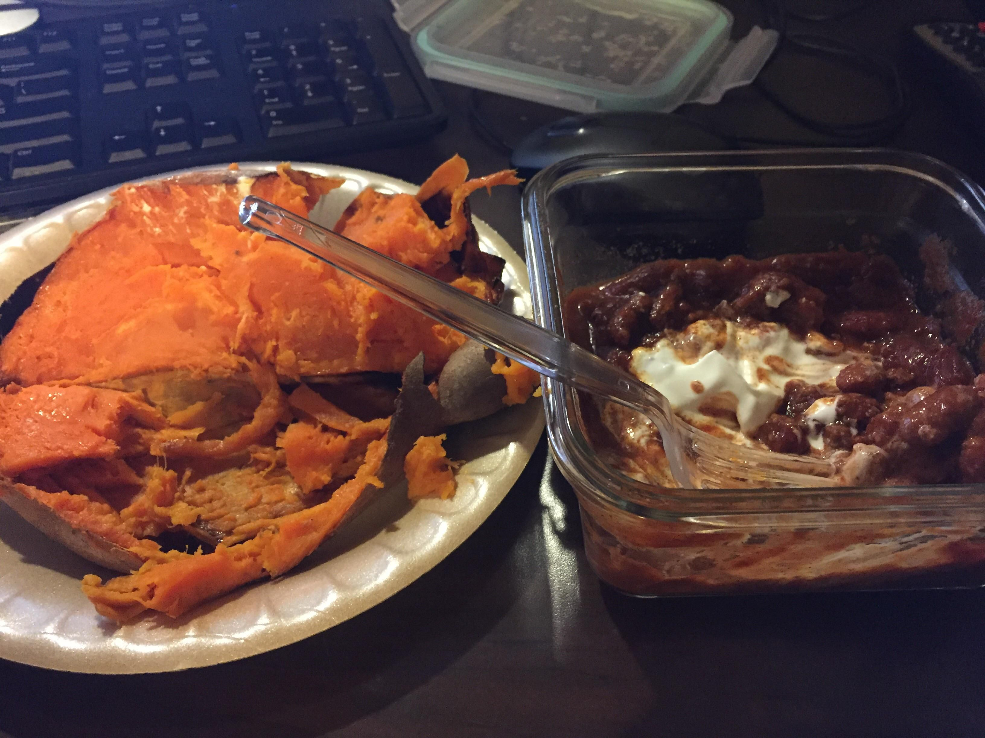 Homemade chili and a baked then microwaved sweet potato