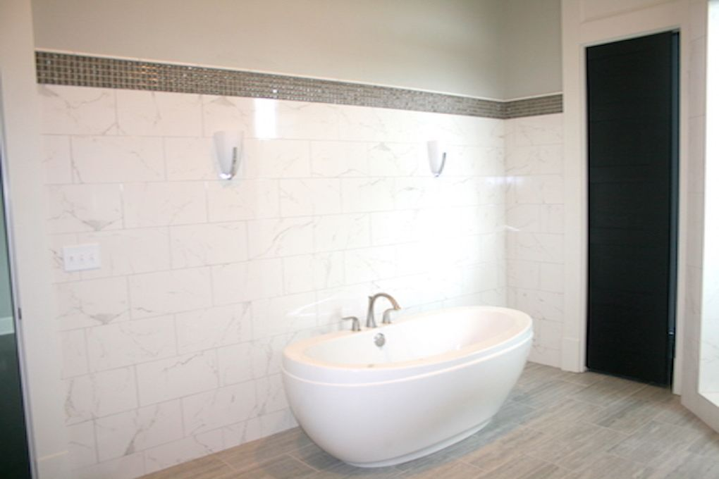 Free Standing Tub With Marble Tile Wainscoting And Mosaic Border Urbantile