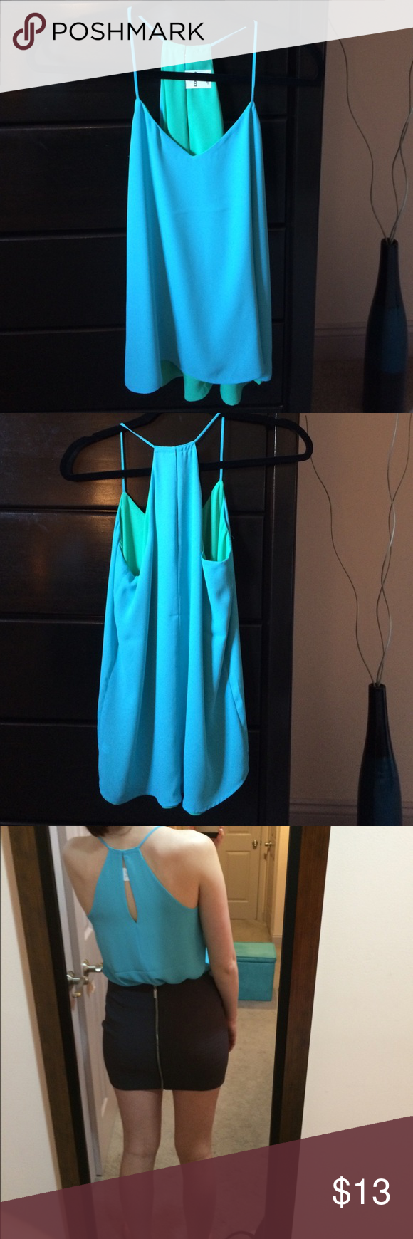 NWOT reversible EXPRESS top Reversible. NWOT. One side is a light turquoisey green, reverse is a light sky blue. Size is an XS but fits S too. (I am a small). Express Tops Tank Tops