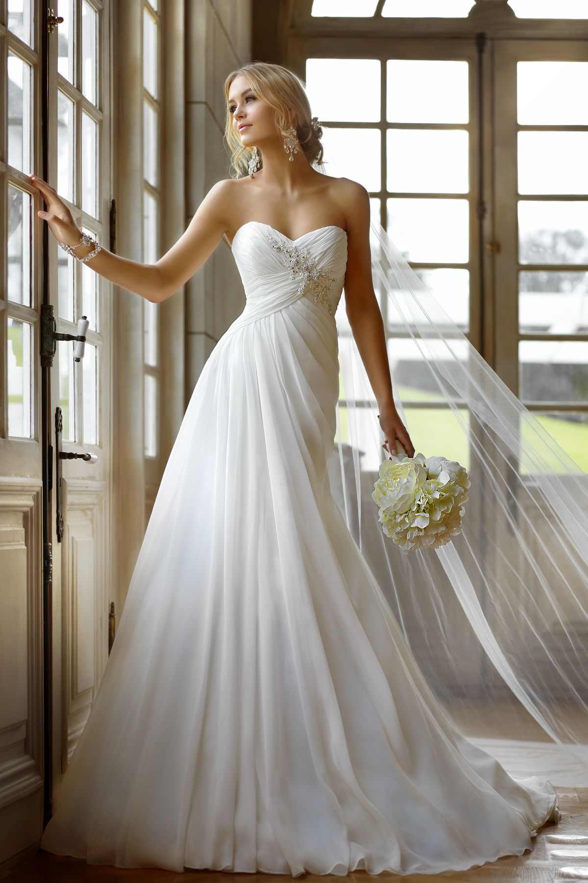 Designer beach wedding dresses  wedding dresses with straps or sleeves  Casual Beach Wedding