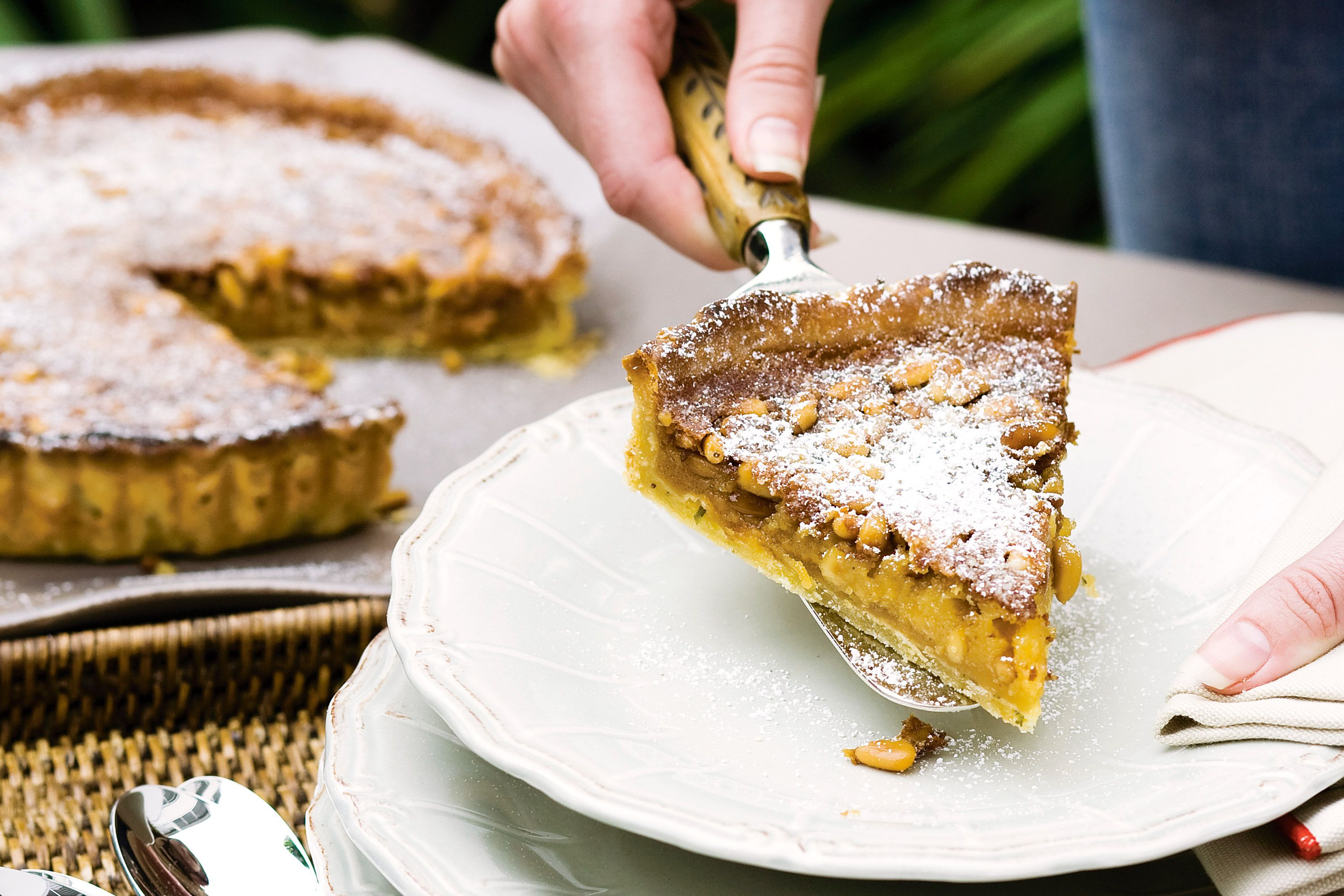 Surprise Mum with the secret ingredient in this sweet, nutty tart - the fresh rosemary hidden in the handmade shortcrust pastry.
