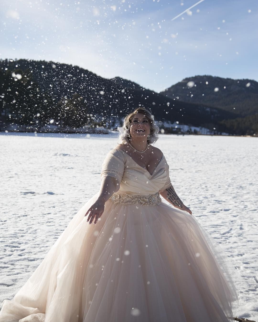 ❄️snowday❄️ #photography @nicole_marcelli  #HMUA @makeup_withmel  #photoassignment @savanaray  #onemonth #onemonthanniversary #married #love #snow #colorado #mountains #lazaro @lazarobridal #kleinfeld #meow #evergreen #snowday #snowballfight #husband #bride #bridal #winter #winterwedding #winterbride #tattoo #photography #curvy #curvybride #honormycurves #hair #makeup #tiedtheknotinlazaro #princess