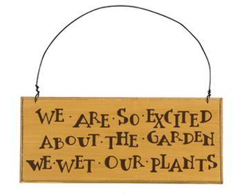 """We are so excited about the garden, we wet our plants!"" Bring some humor to the back-breaking work of gardening. Comical lettering on a neutral-background. Hang from the sturdy wire attached. Wood and wire. 9.5"" x 4"" (http://store.adornwreaths.com/wet-our-plants-sign/)"