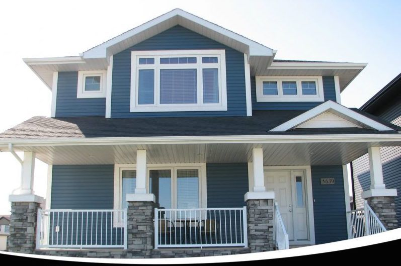 Kaycan Vinyl Siding Cabot Blue Siding With Grey Stone And White Trims Cool Tone Classic Home Exterior Makeover Vinyl Siding Exterior Paint Colors For House