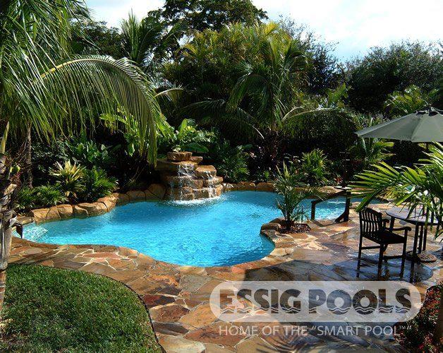 Pool 066 - Natural pool, flagstone deck, imitation rock waterfall