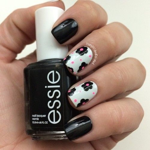Chic black nails with floral design and polka dots