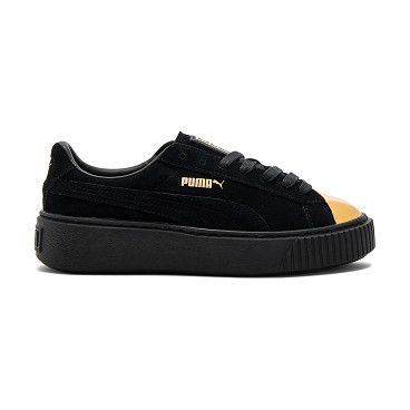 580814a4b8d Suede Platform Sneaker by Puma. Suede upper with rubber sole. Lace-up  front. Metallic toe cap. Platform measures approx 1.25