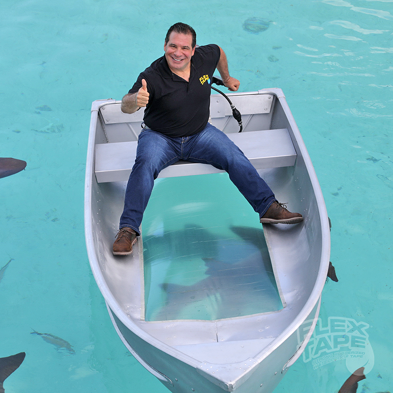 Happy Shark Week Here S A Picture From When Philswiftontv Rode The Flex Tape Clear Boat With Sharks Flex Tape Memes Phil Swift Happy Shark