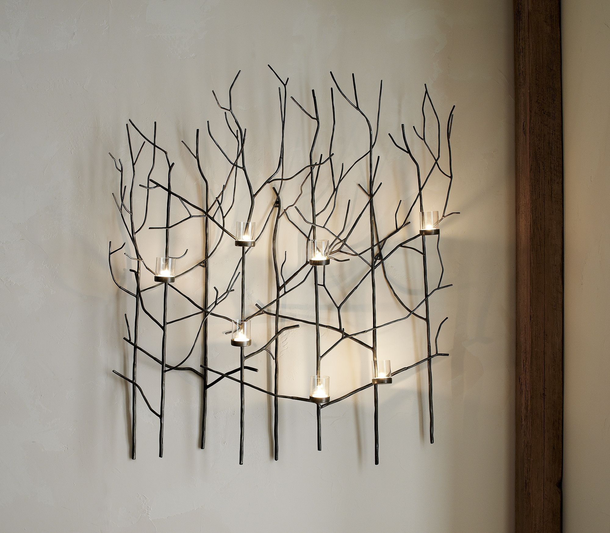 Metal Wall Decor With Candles : Lit with votive candles this nature inspired wall art