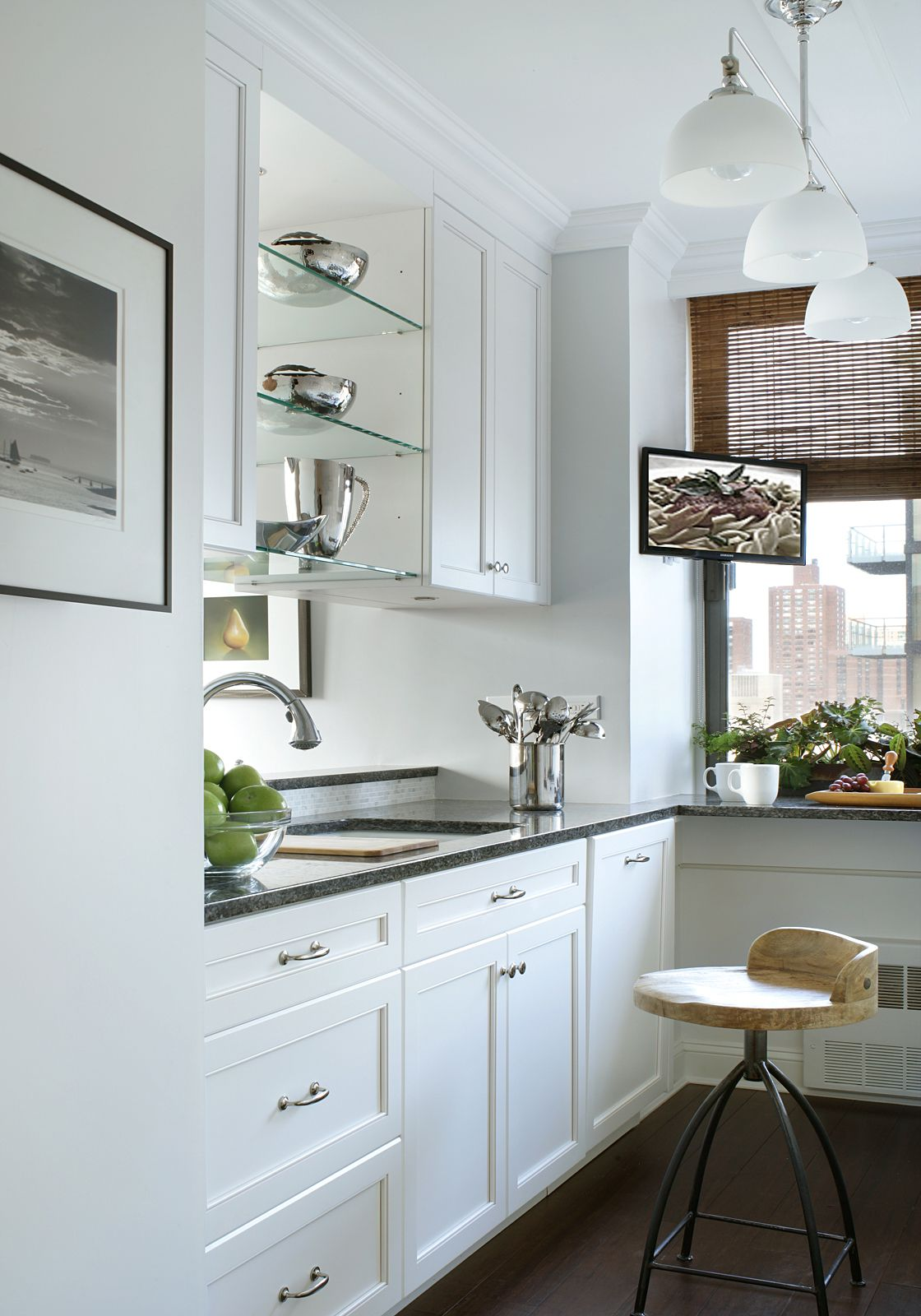 All white shaker style cabinet with a contrasting dark ...