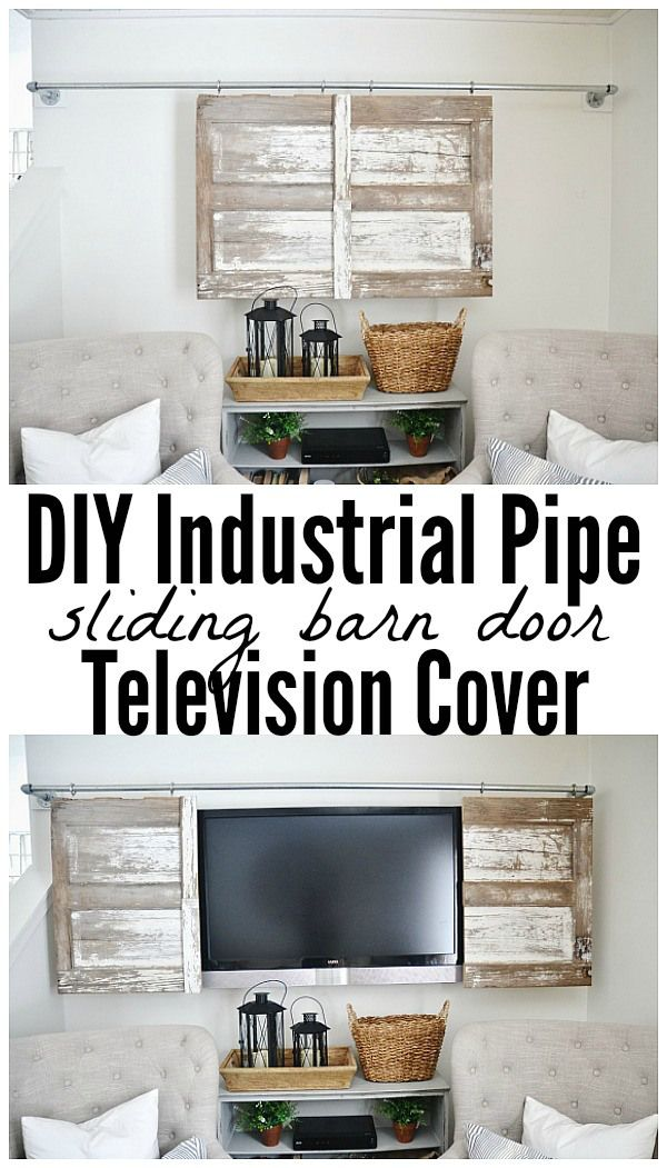 Industrial pipe sliding barn door television cover.