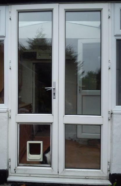 Exterior External White Upvc Double Glazed Patio Doors In Frame With