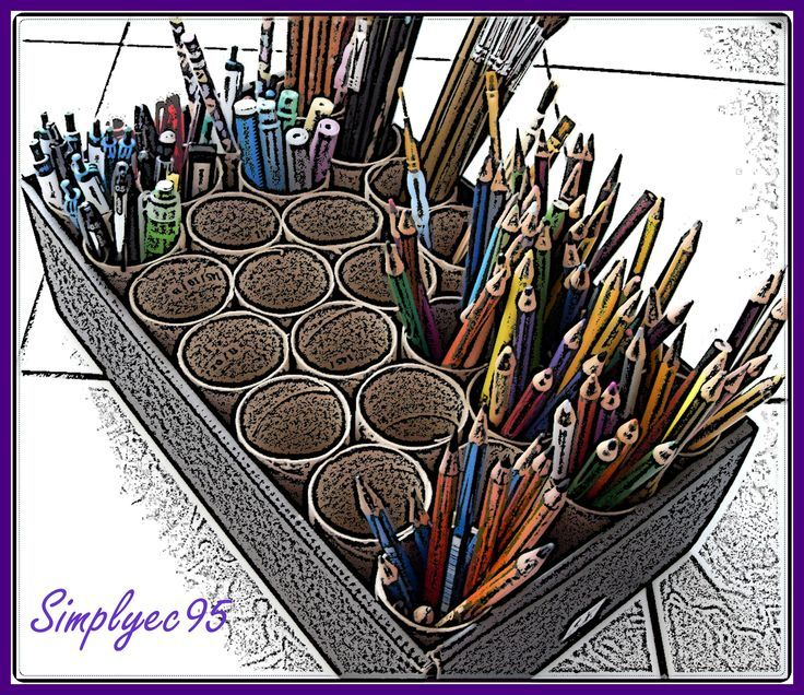 recycled tissue rolls as pencil, pen and paint brush holders... such a great idea for the craft room and the earth as well !!