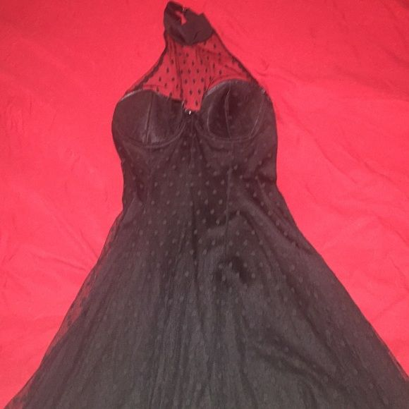 Very sexy black Fredericks of Hollywood dress! Bought this & never worn, very sexy for a petite lady out there to add to their slinky side of the closet! Frederick's of Hollywood Dresses Mini