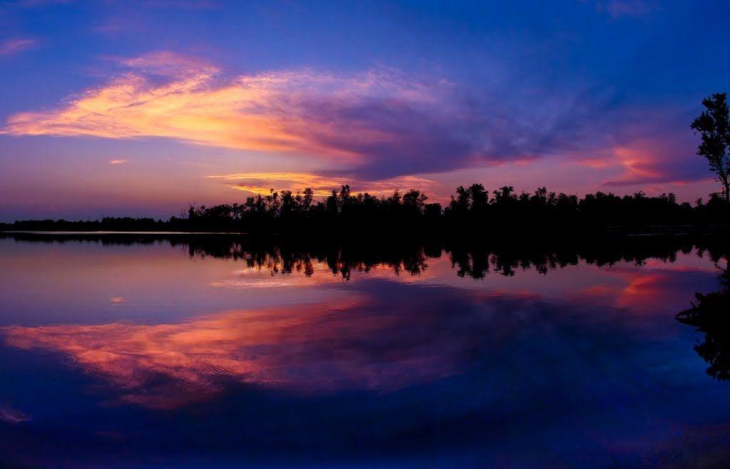 Colorful sunset reflections jacobson park lexington ky