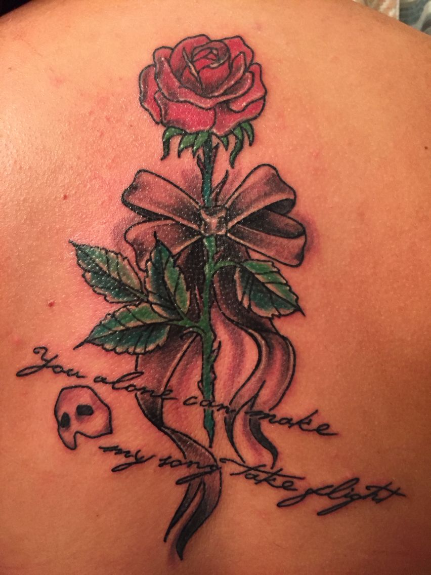 My phantom of the opera tattoo down the middle portion of for Rose tattoo song