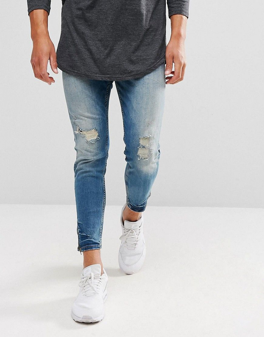 86f383afc62 Pull&Bear Carrot Fit Ripped Jeans With Zipped Hem In Mid Wash - Blue ...