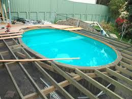 Image Result For Above Ground Pool Deck Over Edge Backyard Pool Landscaping Backyard Pool Pool Landscaping