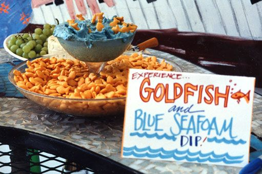 """add blue food coloring to onion dip to make an ocean-themed """"goldfish & blue seafoam"""" party appetizer"""