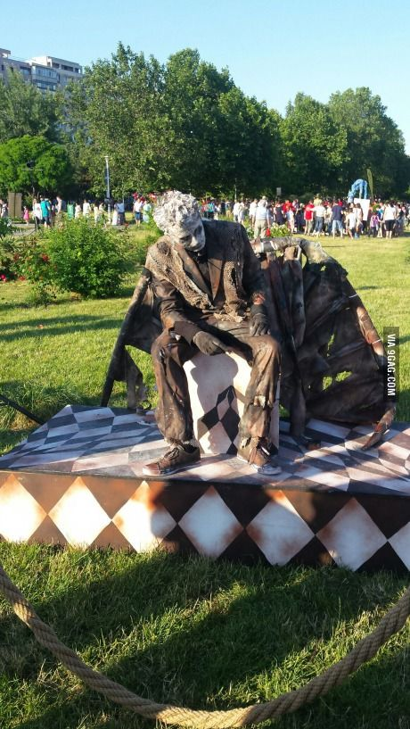 From all the living statues in the park, the fallen angel was the only one alone...