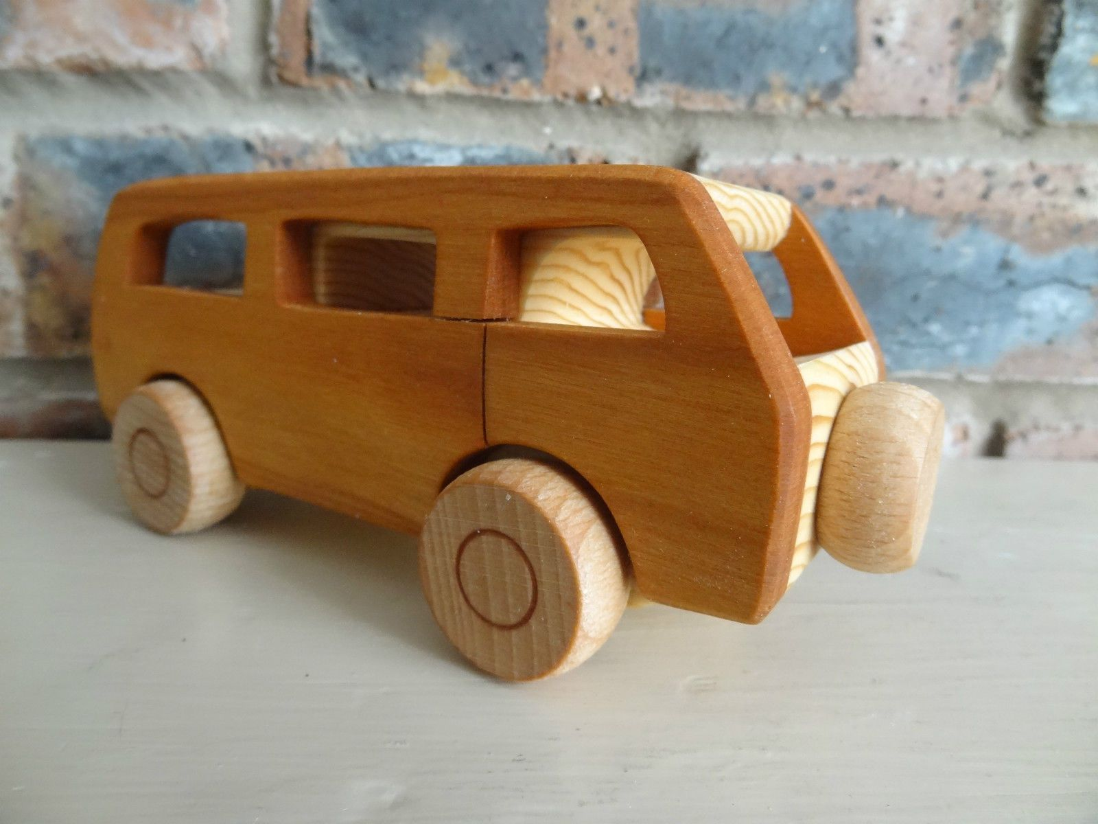 http://www.ebay.co.uk/itm/Wooden-toy-VW-CAMPER-T2-vintage-style-handmade-High-quality/131340862868?_trksid=p2047675.c100011.m1850
