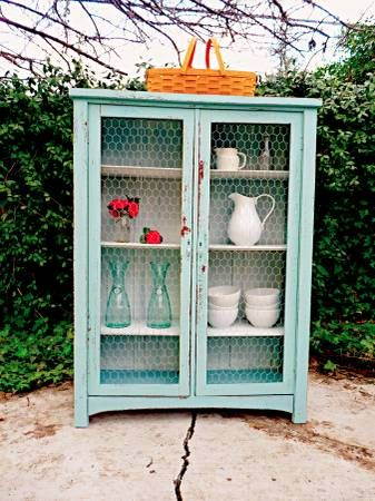 I am in love with this piece! I like how they used the chicken wire for the doors and the color is so perfect.