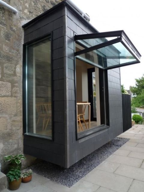 Business Design A House And Window: A Vertically Folding Window That Takes Almost The Whole Wall Opens The Breakfast Space To The