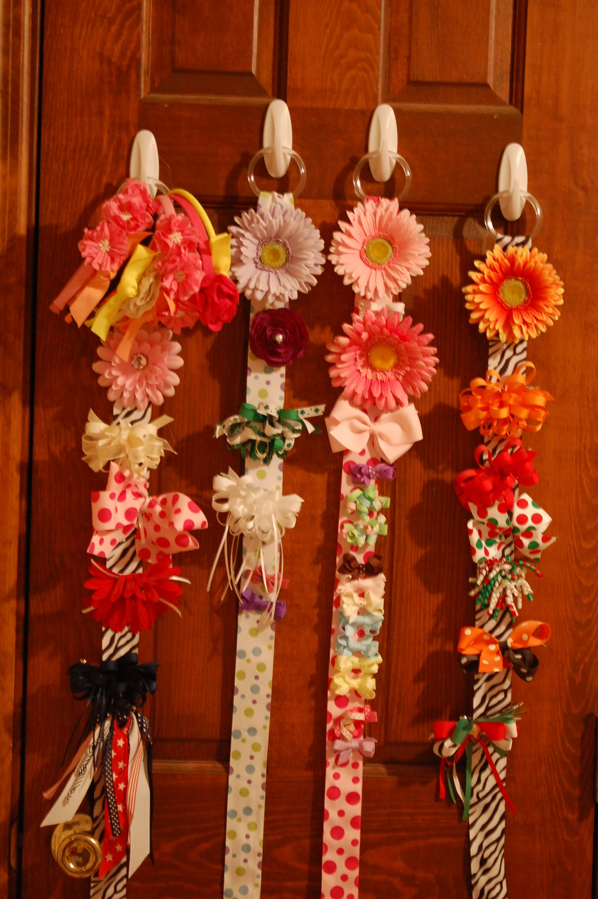 Hair bow organizer use a cheap dollar store shower curtain holder use a cheap dollar store shower curtain holder hot glue adorable ribbon around it then finish off with a happy flower at the top izmirmasajfo Choice Image