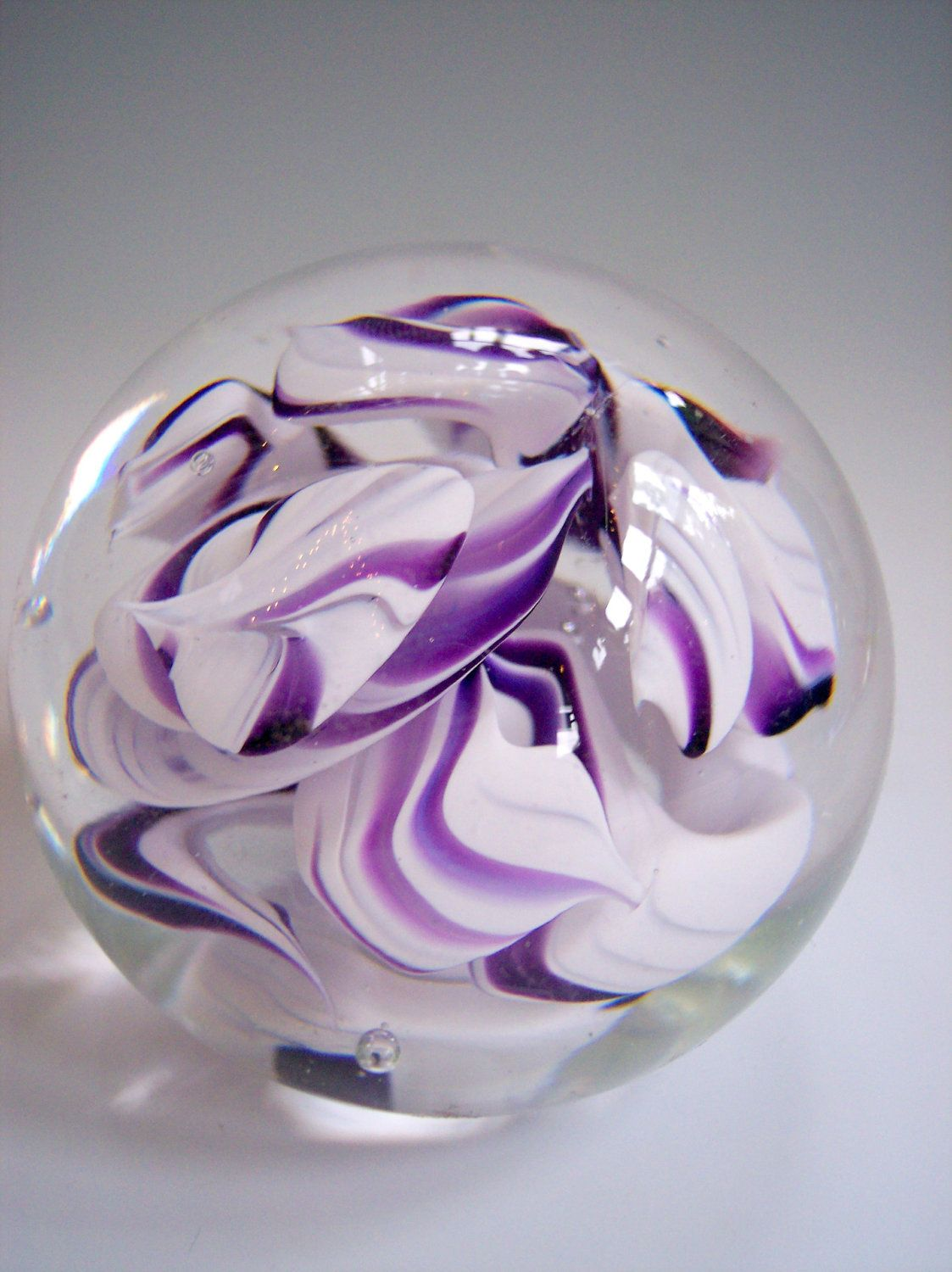 hand blown art glass paperweight in purple and white by bill riker