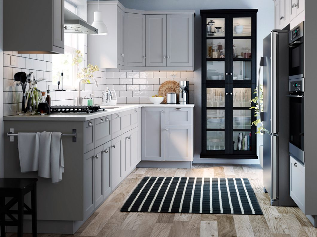 A Small Grey And White Traditional Style Kitchen With LERHYTTAN Grey And Black Stained Glass