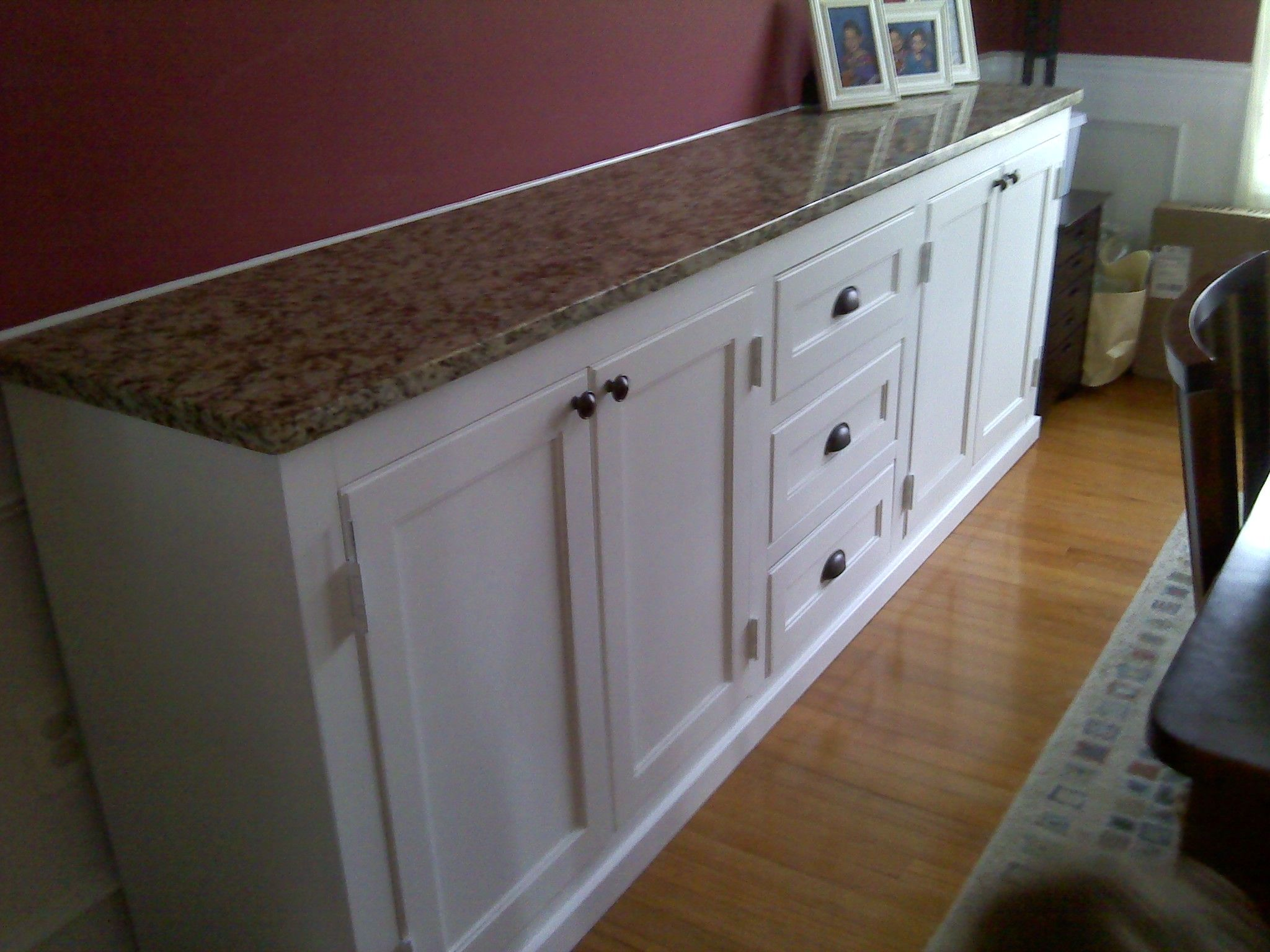 built in dining room buffet storage underneath and matching countertop to kitchen - Dining Room Wall Cabinets