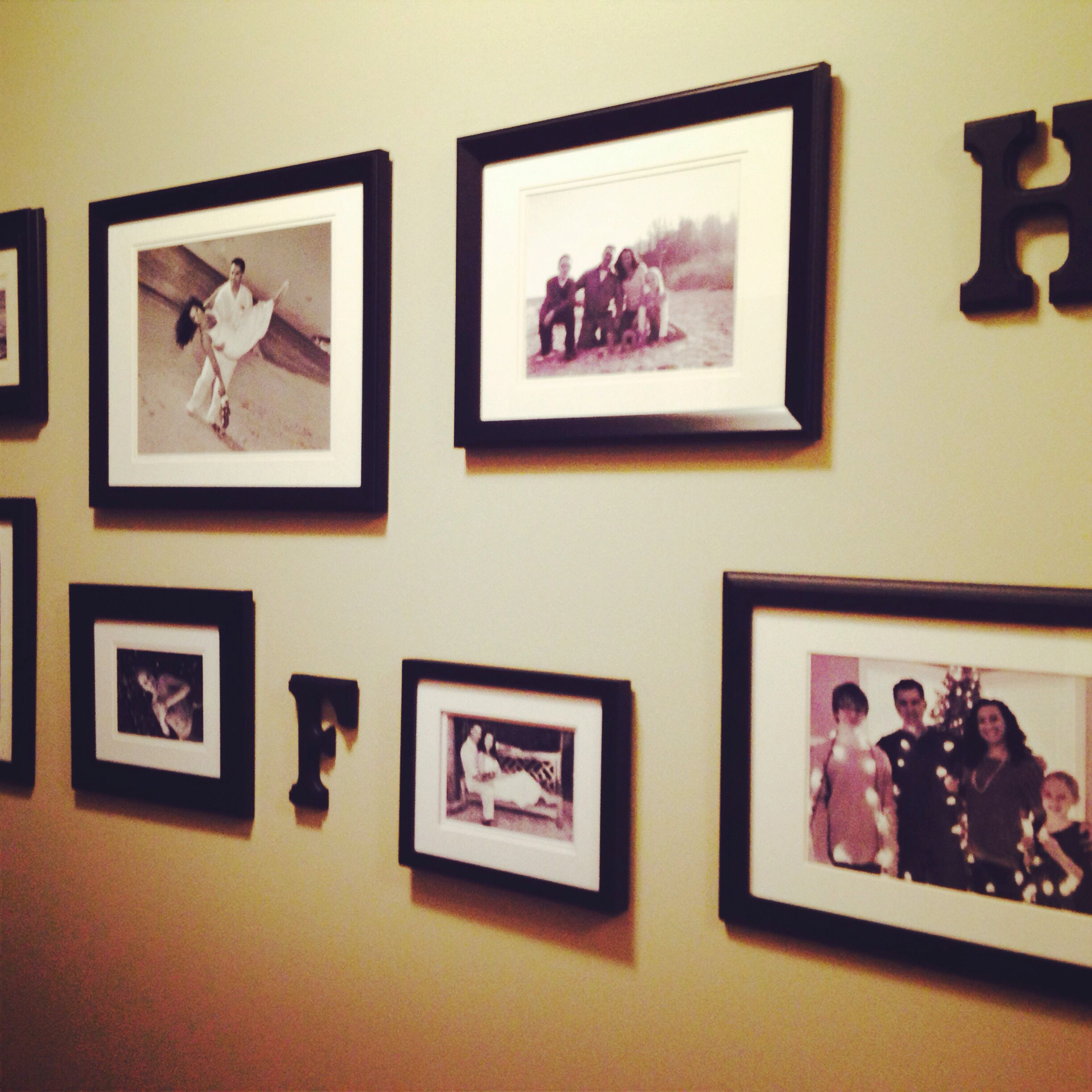 Family Photos Printed In Black And White And Framed In