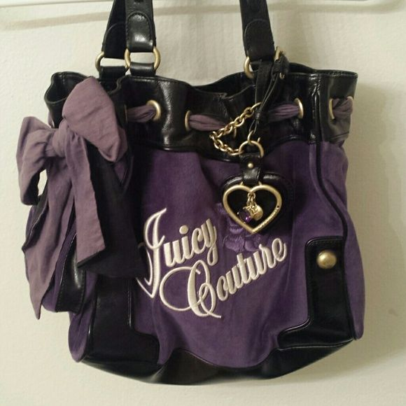 Juicy Coture Hand Bag in Purple Purple Juicy Hand Bag .. Never been used/new with tags Juicy Couture Bags Shoulder Bags