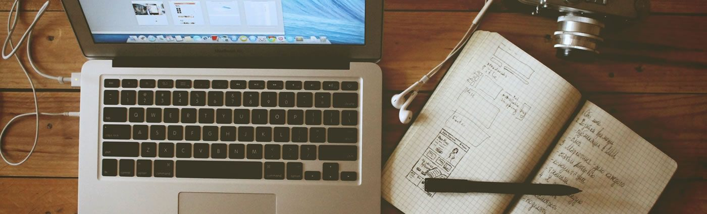 Workspace With Headphones And Notes T S Online Marketing