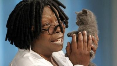 Whoopi Goldberg with a kitten